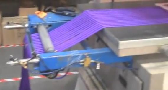 Lanyards being fed into a printing machine